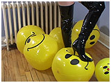 Smiley-face beach balls get foot-popped