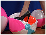Popping beach balls with high heels