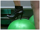 wearing thigh high boots to foot pop balloons