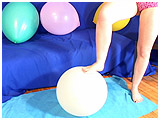 Video clip for sale of Lydiah foot-popping 16-inch balloons