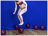 Video clip for sale of Scarlette footpopping balloons by jumping on them