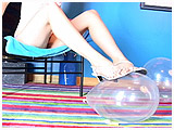 Video clip for sale of Marci foot-popping 12-inch Qualatex balloons