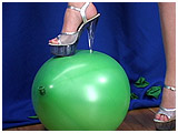 foot popping latex balloons in sky high heels
