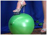 Wearing sky high heels, Alexxia footpops balloons
