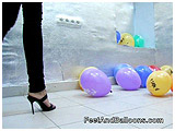 Alena pops balloons with her stiletto heels