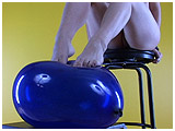 Video clip for sale of Tchii teasing a blue jewel balloon with her bare feet
