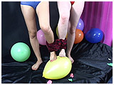Maxima and Xev foot pop balloons with their ankles tied to each other