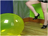 Video clip for sale of Mistress Xev taunting you as she pops your balloons with her heels