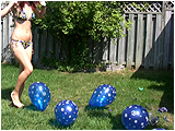 Video clip for sale of Holly and Raven foot popping balloons outside