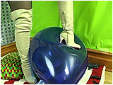 Video clip for sale of Sophie tormenting a balloon with her thigh high boots before heel-popping it