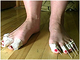Video clip for sale of Miel popping balloons with toothpick toes