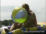inflatable boat and beach ball