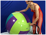 Video clip for sale of Alice using a big hand pump to inflate a giant beach ball