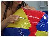 Video clip of Debby using a cigarette to pop a beachball
