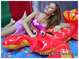 Xena plays with an inflatable lobster