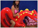 Video clip of Kitty playing with an inflatable dragon