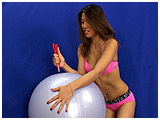 Video clip of Kitty slaughtering an excercise ball with scissors