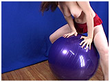 Lizzie rides a fitness ball
