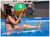 Debby floats about while inflating beach balls