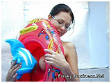 Diva plays with an assortment of smaller vinyl inflatables