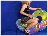 Video clip for sale of Krystal riding a pair of swim rings