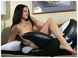 Alexxia inflates and rides a killer whale
