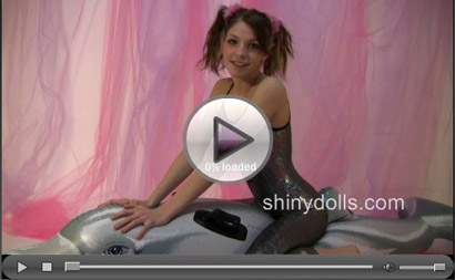 Lola riding an inflatable dolphin in spandex