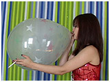 Video clip for sale of Atish smoking and inflating a Qualatex balloon