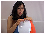 inflating and burning a beach ball