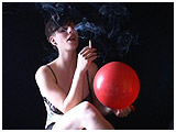 Video clip for sale of smoker Celia puffing while inflating a balloon