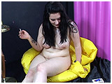 Kat cig-pops an inflatable chair