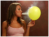 Lisa enjoys a smoke while playing with a pair of balloons