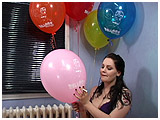 Kat cig-pops a bouquet of helium-filled balloons