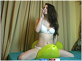 Video clip for sale of Andi riding jellybean balloons while smoking