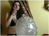 Video clip for sale of Andi smoking while inflating a clear balloon