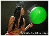 Shana smokes and plays with a balloon