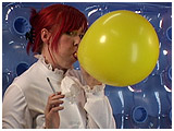 Mistress Xev slowly inflates a balloon while enjoying her 120 cigarette