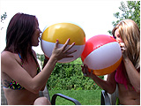 Video clip for sale of Holly and Raven inflating 20-inch beachballs