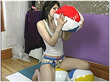 Video clip for sale of Brooke blowing up beach balls in 6 minutes