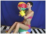 Alice inflates a couple of beach balls and a pair of waterwings