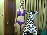 Video clip for sale of Eira riding an inflatable zebra