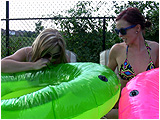 Video clip for sale of Holly and Raven inflating big swimrings together