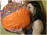 Video clip for sale of Andi inflating beachballs