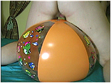 Video clip for sale of Miel bouncing on a beachball