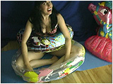 Heather sits within an Ed Hardy swimring while mouth-inflating a splash pool