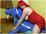 Video clip for sale of Xev riding and popping an inflatable blue walrus