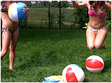 Video clip for sale of Holly and Raven bum-popping 20-inch beachballs