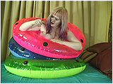 Video clip for sale of Xev popping three swim rings