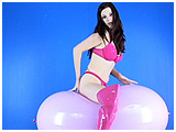 Video clip for sale of Alexxia bouncing on a big balloon
