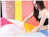 Video clip for sale of Alexxia deflating a giant beach ball